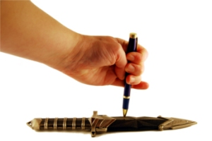 The pen is mightier than the sword as shown with a writing utensil and a dagger